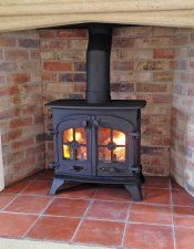 Stone fireplace, quarry tile hearth and brick chamber