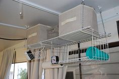 Maybe It's Just Me: Pop up Camper Makeover - Hanging shelving for the pop up, great storage idea
