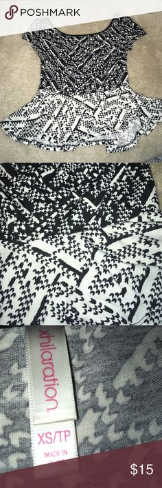 Black and white peplum shirt Black and white patterned peplum shirt. Faux leather neckline. Literally the cutest shirt I've ever owned, but it doesn't fit anymore and I only ever wore it like once 😩 It looks super cute with black bodycon or pencil skirts 😊 Xhilaration Tops Blouses