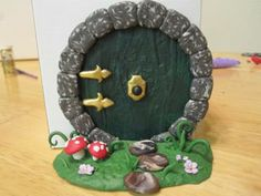 Think I'll make a hobbit terrarium mini garden and will need to make a hobbit door.  So cute.  This has a tutorial also.Creator's Joy: Hobbit Doors out of Fimo or Sculpey: polymer clay fairy house