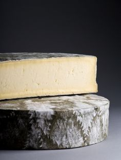Cornish Yarg: Cornish Yarg is a semi-hard cow's milk cheese made in Cornwall, England, United Kingdom from the milk of Friesian cows. Before being left to mature, this cheese is wrapped in nettle leaves to form an edible, though moldy, rind. The texture varies from creamy and soft immediately under the nettle coating to a crumbly texture in the middle.