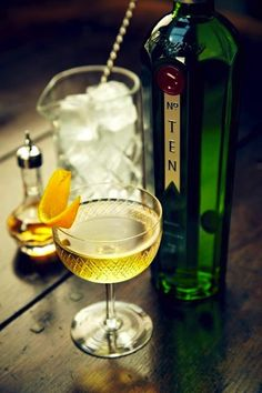 The Dean (35ml Tanqueray® No.Ten Gin, 7ml Italian Vermouth, 3 twists of Sicilian Orange, 2 dash Graphfruit Bitters | Method: Stir all ingredients with a block of ice in a mixing glass. Pour into glass and garnish with orange twist.)