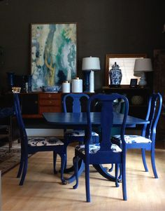 Dining Room Set painted by Sisters Unique with Annie Sloan Chalk Paint®. Chairs were done in a 2 Color Distress technique with French Linen and Napoleonic Blue with a custom mix of Clear and Dark Wax. Table was painted with a combination of Greek Blue, French Linen, Napoleonic Blue, and Napoleonic Blue/Graphite Mix with Clear Wax.