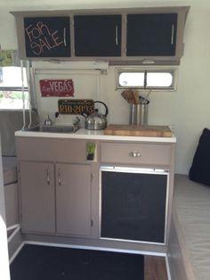 Batwing Betty red/white boler blackboard kitchen.