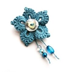 Beautiful Crochet Brooch. Love this turquoise blue too.