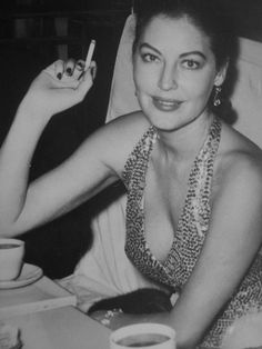 Ava Gardner at the premiere of The Barefoot Contessa, 1954.....Uploaded By www.1stand2ndtimearound.etsy.com