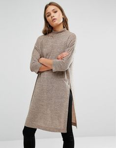 Buy it now. New Look Side Split Tunic Top - Beige. Tunic Top by New Look, Stretch knit fabric, High neckline, Mid length sleeves, Side split detail, Regular fit - true to size, Machine wash, 95% Polyester, 5% Elastane, Our model wears a UK 8/EU 36/US 4. ABOUT NEW LOOK Offering irresistible fashion and fast off the catwalk styles, New Look joins the ASOS round up of great British high street brands. Bringing forth their award-winning clothing collection of dresses, jeans and jersey basics…