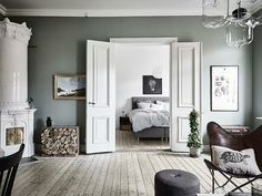 Living room with double doors to the bedroom