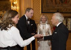 The Duke of Cambridge with Ricky and Ralph Lauren and Royal Marsden CEO Cally Palmer. He said: 'I'm sorry my wife's not here, you probably would far rather you saw my wife.' 'Not at all,' replied Mr Lauren. 13 May 2014