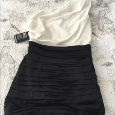 Express one shoulder color block rouched dress sz4 New with tags Express one shoulder rouched color block dress- black and white size 4. Invisible zipper. Express Dresses One Shoulder