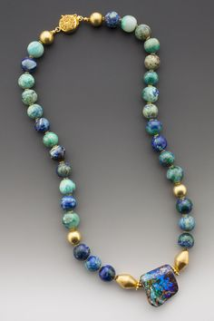 """Sweet Oasis: An Australian boulder opal with restful reservoirs of cool blue stretching into infinity. On round, charmingly unsophisticated beads of azurite interspersed with 18K gold beads. Pendant drop 1"""". ElleSchroeder.com"""