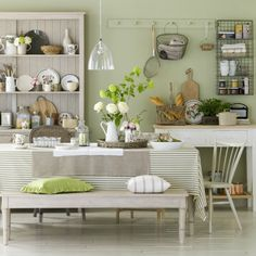 Enhance a country kitchen decor style with decorative green items for a nature-inspired look. Use nature as your inspiration when doing a green country kitchen decor, and create a peaceful place in which to eat and spend time with friends and family. Green Dining Room, Country Dining Rooms, Dining Room Design, Country Bedrooms, Country Cottage Interiors, Dining Area, Dining Bench, Home Decor Kitchen, Kitchen Furniture
