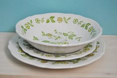 "Set of 16 (4 Salad plate, 4 saucers, 4 bowls) produced by Sears China in 1978. The pattern was named ""Petite Flora"" and features a yellow flowers with light spring green leaves, set on white ironstone with a scalloped edge. Dishwasher safe and oven proof $20.00"