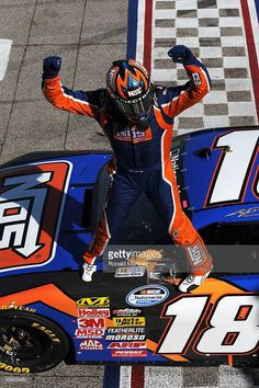 Kyle Busch, driver of the #18 NOS Energy Drink Toyota, celebrates from on top of his car after winning the NASCAR Nationwide Series O'Reilly 300 at Texas Motor Speedway on April 4, 2009 in Fort Worth, Texas.