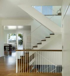 White metal banister with wood hand rail