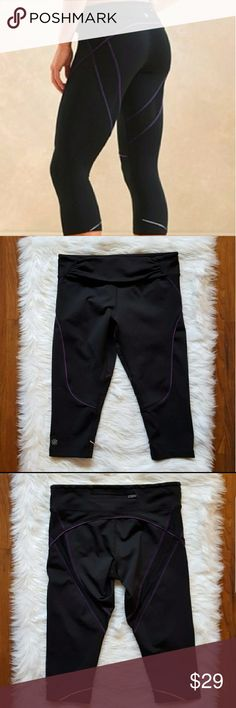 "athleta quick step black capri leggings Nice pair of Quick Step capris by Athleta in excellent condition. Zipper pocket on back waistband.  Measurements lying flat:  Waist: 14"" Length: 17""  -Smoke-free home  -Reasonable offers welcome, but prices are firm on items under $10.  -No trades, please.  -All measurements are approximate.  Thank you for shopping my closet, it means a lot! Athleta Pants Leggings"