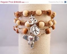 ON SALE Adjustable Brown and Natural Hemp Multi-bracelet w/Wooden Beads and Metal Charms (Elephant, Om(Ohm),Peace Sign Charms) on Etsy, $14.40