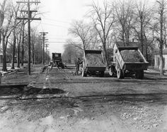 Two Dump Trucks (1930) This picture shows two dump trucks and a leveling grader working on the roads in Provo