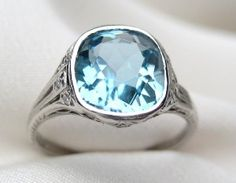 Of course I would go looking for an alternative graduation ring and find this $9,000 vintage Tiffany Aquamarine instead.