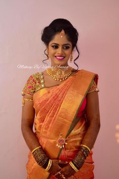 Vaishnavi is all smiles after her makeover for her reception. Makeup and hairstyle by Vejetha for Swank Studio. Pink lips. South Indian bride. Eye makeup. Bridal jewelry. Bridal hair. Silk sari. Bridal Saree Blouse Design. Indian Bridal Makeup. Indian Bride. Gold Jewellery. Statement Blouse. Tamil bride. Telugu bride. Kannada bride. Hindu bride. Malayalee bride. Find us at https://www.facebook.com/SwankStudioBangalore
