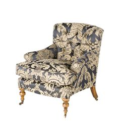An unusually elegant occasional chair with scrolling lines and a deep buttoned back.