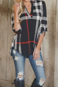 Arrive to your next meeting in style with this must have Pretty Little Things Plaid top! Full of class and comfort you'll want to wear it on the weekends too! Long Sleeve with black, ivory and red pla