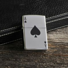 "Baby Keepsake: Personalized Zippo Aces Lighter by JDS Marketing. $32.95. Measures 1 1/1"" x 2 1/8"" x 1/2"".. Personalize with 2 lines up to 15 characters per line. (Please email us your personalization detail).. From the first name in lighters comes this sleek selection, perfect for the card shark. The personalized Zippo Aces Lighter features the lucky Ace of Spades on front and lots of room for name or other inscription on the back. The Zippo name means long-lasting..."