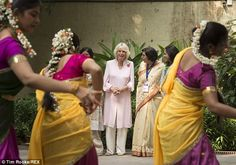 Camilla watches a dance performance during her visit to the home for abandoned and abused children