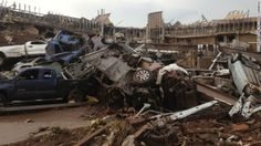 At least 51 people were killed Monday when a powerful tornado blasted an area outside of Oklahoma City, ripping roofs off buildings and leveling homes. Oklahoma City, Oklahoma Tornado, Tornado Alley, Powerful Pictures, Weather News, Airlie Beach, Weather Underground, After The Storm, Tornadoes
