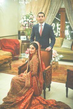 Indian wedding photography. Couple photo shoot ideas. Indian bride wearing bridal lehenga and jewelry. #IndianBridalHairstyle #IndianBridalMakeup #IndianBridalFashion #BridalPhotoShoot