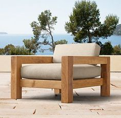 RH's Colorado Lounge Chair:A salute to clean and contemporary style, our collection celebrates the beauty of unadorned Russian reclaimed oak. Free of ornamentation, the design is defined by its lower, more relaxed silhouette. Expert craftsmanship makes the most of the weathered character that the wood has accumulated over decades.
