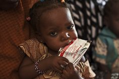 A little girl in Niger eating her ready to use therapeutic food ©ACF_ courtesy S Hauenstein Swan