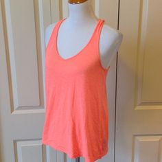 Neon orange racer back tank 65% polyester 35% rayon Boutique Tops Tank Tops