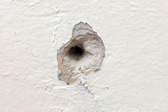 como tapar buraco na parede