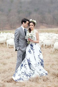 Groom in grey suit and bride in floral printed wedding dress @myweddingdotcom