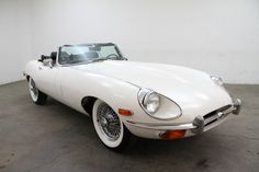 1970 Jaguar XKE Roadster, Series II – in Old English White with black interior. This car comes with 4-speed manual transmission and wire wheels. This is a very presentable weekend driver that is mechanically sound.