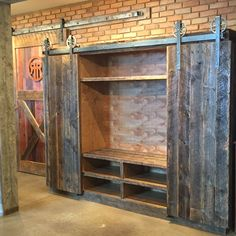 Crafted with reclaimed barn wood. Rolling barn w… Bob's entertainment center. Made from recycled barn wood. Roll-up doors made of barn wood Barn Door Closet, Diy Barn Door, Barn Door Designs, Cool House Designs, Diy Entertainment Center, Reclaimed Barn Wood, Rustic Barn, Interior Barn Doors, Wood Doors