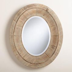 Bring natural appeal to your décor with our Gray Julian Mirror. Its thick oval profile and beveled mirror give it a substantial look. Natural wood grain shows through the subtle gray wash, lending an earthy quality.