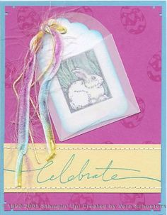 Pink Passion paper is the perfect backdrop for the colorful fibers draped on this handmade Easter card. The bunny has been colored with watercolor pencils and tucked into a mini vellum envelope.