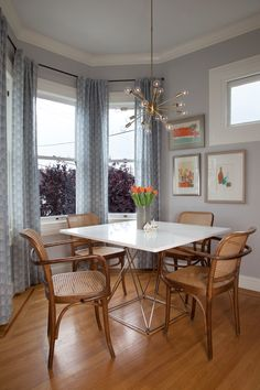 sputnik light Dining Room Transitional with bay window blue curtains cane chair…