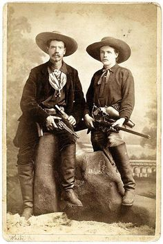 "This 1879 Leadville, Colorado, image shows two noted Westerners, (at left) Joseph ""White Eye"" Anderson, who accompanied Wild Bill Hickok to Deadwood in 1876, and his friend E. B. ""Yankee"" Judd. Judd is packing a First Model Army Merwin Hulbert revolver in his holster and is holding what appears to be a Sharps Borchardt 1878 rifle."