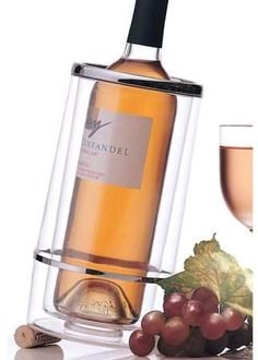 Prodyne Acrylic Iceless Wine Cooler ~~ Keeps wine chilled for hours without ice. Insulated chamber of cold air is created from the chill of the bottle. Made from durable crystal clear acrylic with bright chrome accents. Wine Bucket, Gadgets, Packing A Cooler, Wine Chillers, Wine Pourer, Expensive Wine, Cheap Wine, Sparkling Wine, Bar
