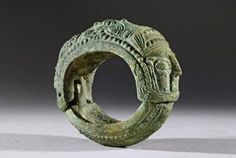 MESOPOTAMIAN BRONZE BRACELET WITH FEMALE HEADS: DATE: 1200 BC - 8th Century BC…