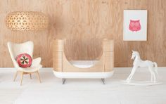This is the coolest baby furniture company.  They use plexiglass instead of wooden spokes so your baby doesn't get caught and you can see everything that goes on in there, all with a mid-century modern flare!  Love it!