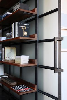 Clean iron work + wood.  Warm touch to a masculine design