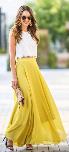 White top and long yellow skirt. Animal Print Clutch.