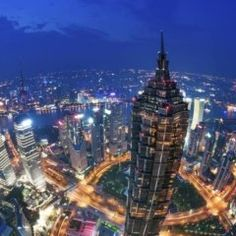 This is an image of the developed world where a big building is seen in a lot of places where a city with a light illuminated a big tower is very beautiful. Big Building, Burj Khalifa, Empire State Building, Times Square, Tower, China, Country, World, Places
