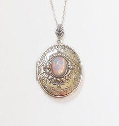 Silver Locket necklace. Pink Fire Opal by TwilightsCastle