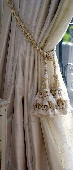 Silk draperies with tassel tiebacks