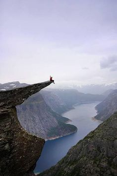 Daredevils perform stunts on Troll's Tongue in Norway – in pictures